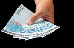 Giving twenty euro notes Royalty Free Stock Photo