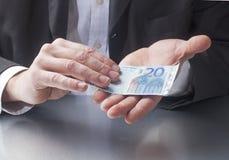 Giving twenty euros for a deal Stock Image
