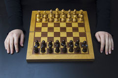 Giving up. Hard to move while playing chess Stock Photography