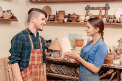 Giving a vase to the potter Stock Photography