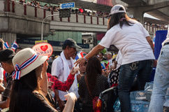 Giving water at the antigovernment demonstration Thailand Royalty Free Stock Photos