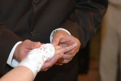 Giving the wedding ring Stock Photos