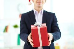 Giving xmas present Royalty Free Stock Photo