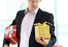 Giving xmas present Stock Images