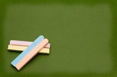 Giz e placa coloridos Fotografia de Stock