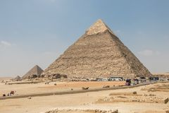 Giza, Egypt - April 19, 2019: The Pyramid of Khafre and the Pyramid of Menkaure at Giza. The pyramid of Cheops is the first of the seven wonders of the world and stock photography