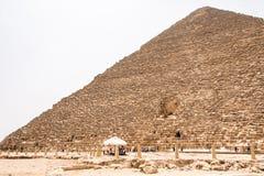GIZA, EGYPT 25.05.2019 Security guards at entrance to pyramid at Giza in Cairo Egypt. GIZA, EGYPT - NOVEMBER 19, 2011: Security guards at entrance to pyramid at stock photos