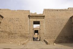 Buildings and columns of ancient Egyptian megaliths. Ancient ruins of Egyptian buildings. Giza Museum Complex, Egypt - 27 August 2017: Buildings and columns of Stock Photography