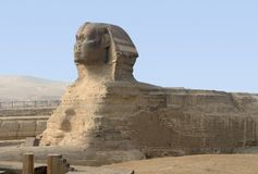 Giza Necropolis. The Sphinx at Giza Necropolis in Egypt Royalty Free Stock Photo