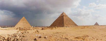 Giza pyramid complex on the background of clouds Stock Photos