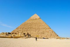 Giza pyramid in Egypt. On blue sky background Royalty Free Stock Photography