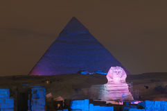 Giza Pyramid and Sphinx Light Show at Night - Cairo, Egypt. CAIRO, EGYPT - JANUARY 1, 2009: Giza pyramid and Sphinx light up for magical sound and light show Stock Photos