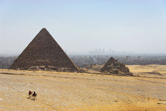 Giza Pyramids and the Cairo City. Giza is most famous as the location of the Giza Plateau: the site of some of the most impressive ancient monuments in the world stock images