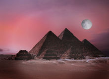 Giza Pyramids Egypt. Fantasy twilight scene -The Giza pyramids before sunrise Royalty Free Stock Photos