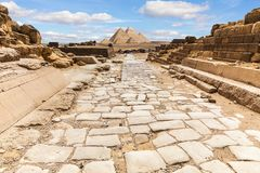 Giza Temple ruins and the road to the Great Pyramids, Egypt stock images