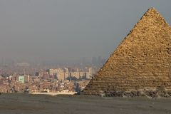 Giza X. One of the pyramids at Giza with the city of Cairo in the background Royalty Free Stock Photography
