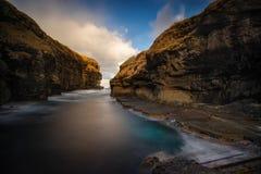 Gjogv little harbour. Little harbour of Gjogv village between sharp cliffs, Faroe Islands stock photos