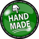 gjord grön hande för knapp Arkivfoto