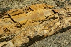 Gjord randig textur av naturligt stenar och skräp av vaggar av olika format som den original- bakgrunden arkivfoto