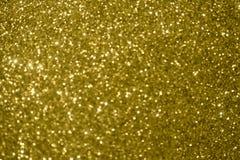 Gjord suddig bakgrund, guld- jultextur fotografering för bildbyråer