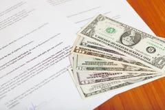 gjorda pengar för avtal avtal Arkivfoton