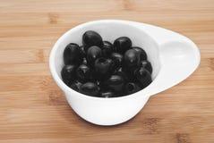 Gjorde full av hål svarta oliv Royaltyfri Fotografi