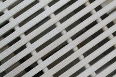 Gjorde randig moderna plast- streckade linjer texturerad modell för abstrakt färg för bakgrund vit diagonalen, Royaltyfri Foto