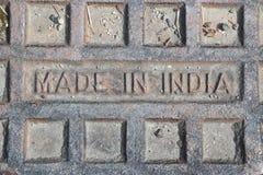 Gjort i den Indien stämpeln för affischtavlor eller främre räkningar av import- eller exporttidskrifter royaltyfri foto