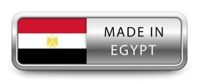 GJORT I EGYPTEN det metalliska emblemet med den isolerade nationsflaggan på vit bakgrund vektor illustrationer