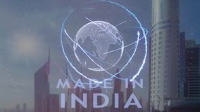 Gjort i Indien text med hologrammet 3d av planetjorden mot bakgrunden av den moderna metropolisen stock illustrationer