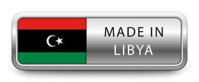 GJORT I LIBYEN det metalliska emblemet med den isolerade nationsflaggan på vit bakgrund vektor illustrationer