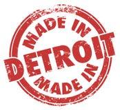 Gjort i logo för emblem för emblem för Grunge för stämpel för färgpulver för Detroit ord röd Royaltyfri Bild