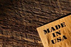 Gjort i papper för USA Grunge på gammal Wood bakgrund Royaltyfri Foto