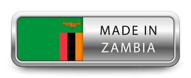 GJORT I ZAMBIA det metalliska emblemet med den isolerade nationsflaggan på vit bakgrund royaltyfri illustrationer