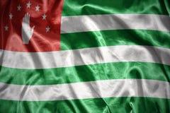 glänsande abkhazian flagga Royaltyfri Fotografi