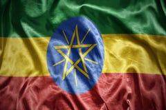 glänsande ethiopian flagga Arkivfoton