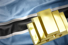 Glänsande guld- guldtackor på den Botswana flaggan Arkivfoto