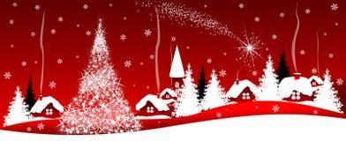 Glänsande julstjärna över byn royaltyfri foto