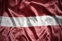glänsande latvian flagga Royaltyfri Fotografi