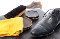 Glänzende Ausrüstung des Schuhes Stockfoto
