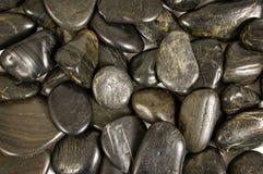 Glänzende Fluss-Felsen oder Steinhintergrund Lizenzfreie Stockfotografie