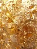 Glänzende gelbe Blattgoldfolienbeschaffenheit Stockbild