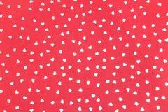 Glänzende Herzen auf rosa Hintergrund lizenzfreie stockfotos