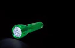 Glänzende Leuchte der grünen Taschenlampe Lizenzfreie Stockfotos