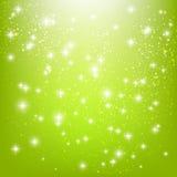Glänzende Sterne auf Grün Lizenzfreie Stockfotos