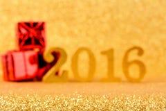 Glänzender funkelnder Hintergrund 2016 der Unschärfe Gold Stockfotos
