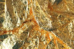 Glänzender gelbes Goldfolienhintergrund Goldmetallischer Hintergrund stockfoto