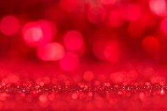 Glänzender heller roter Hintergrund mit bokeh Effekt stockbild