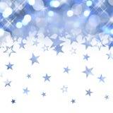 Glänzender Regen von blauen Pastellsternen Stockfoto