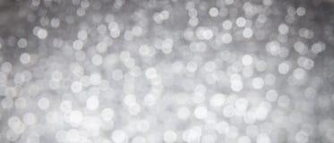 Glänzender silberner abstrakter bokeh Hintergrund Stockfotografie